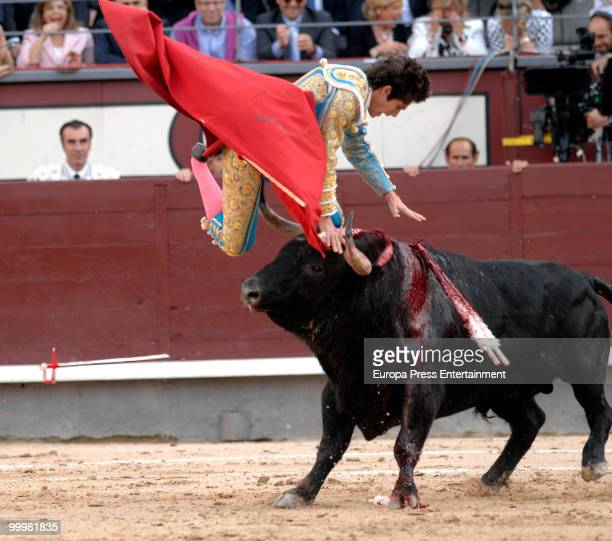 Matador El Cid is tossed into the air by the bull during the San Isidro Fair Bullfight on May 18 2010 in Madrid Spain