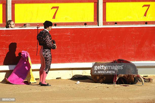 A matador looks at a dead bull after a bullfight of the San Fermin festival on July 12 in Pamplona northern Spain AFP PHOTO / A ARRIZURIETA