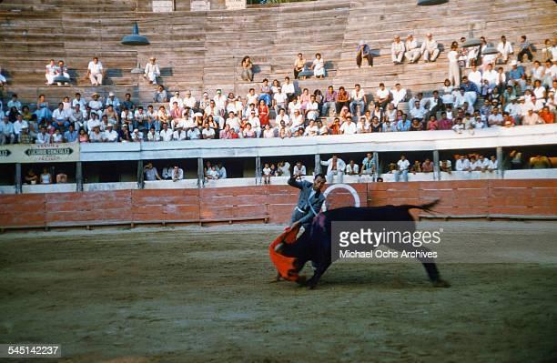 A matador waves a red cape during a bullfight in Mexico City Mexico
