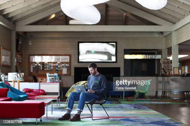 Matakana Cinema owner Dan Paine works on his laptop in the cinema foyer in preparation for re-opening next week on May 22, 2020 in Auckland, New...