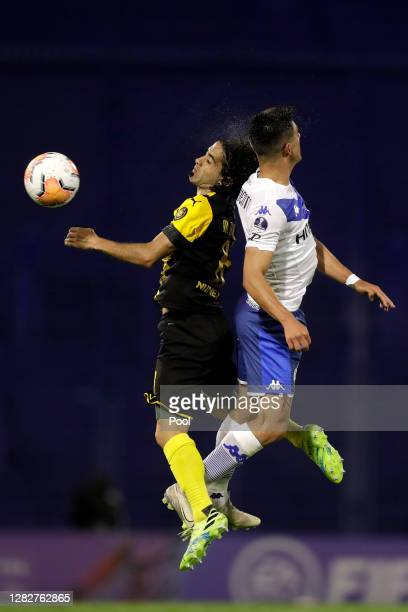 Matías Britos of Peñarol heads the ball against Hernán De La Fuente of Velez during a second round match of Copa CONMEBOL Sudamericana 2020 between...