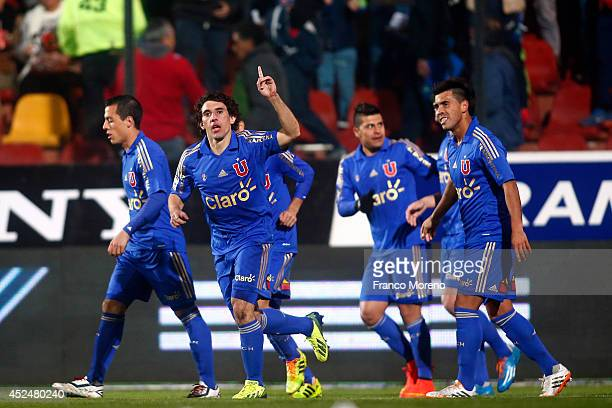 Mat'ías Corujo of U de Chile celebrates with his teammates after scoring the opening goal during a match between U de Chile and Cobresal as a part of...