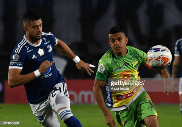 Matías de los Rios of Millonarios fights for the ball with Omar Duarte of Atletico Huila during a match between Millonarios and Atletico Huila at...