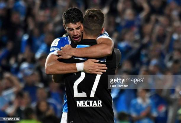 Matías De los Santos and Nicolas Vikonis of Millonarios celebrate after winning the first leg match between Millonarios and Independiente Santa Fe as...