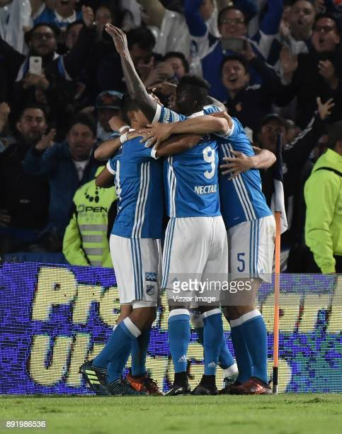 Matías De los Santos of Millonarios celebrates with teammates after scoring the first goal of his team during the first leg match between Millonarios...