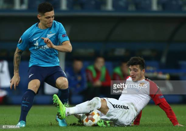 Matías Kranevitter of FC Zenit Saint Petersburg and Vanja Markovic of FC Real Sociedad vie for the ball during the UEFA Europa League Group L...