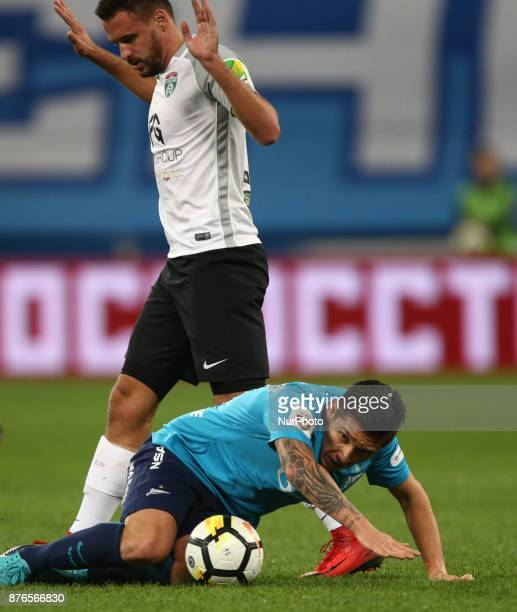 Matías Kranevitter of FC Zenit Saint Petersburg and Yevgeni Markov of FC Tosno vie for the ball during the Russian Football League match between FC...