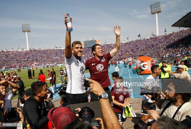 Matías Zaldivia of Colo Colo and teammates celebrate after winning a match between U de Chile and Colo Colo as part of Torneo Scotiabank 2018 at...