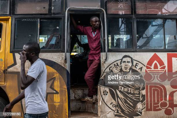 A matatu conductor waits for passengers at a bus stop on December 04 2018 in Nairobi Kenya The private minibuses were to have been banned from the...