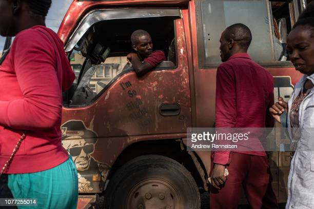 A matatu driver waits for more passengers at a bus stop on December 04 2018 in Nairobi Kenya The private minibuses were to have been banned from the...