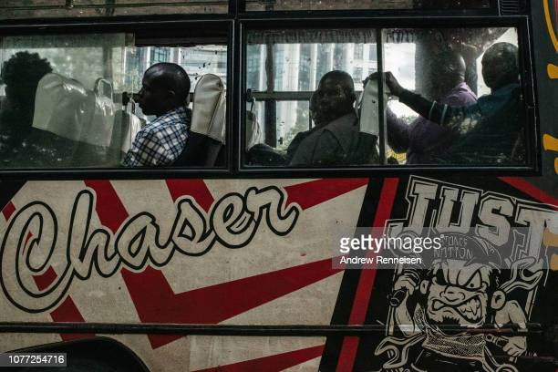 A matatu loaded with passengers waits at a bus stop on December 04 2018 in Nairobi Kenya The private minibuses were to have been banned from the...