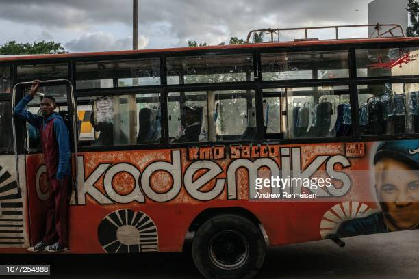 A matatu passes a bus stop on December 04 2018 in Nairobi Kenya The private minibuses were to have been banned from the city's central business...