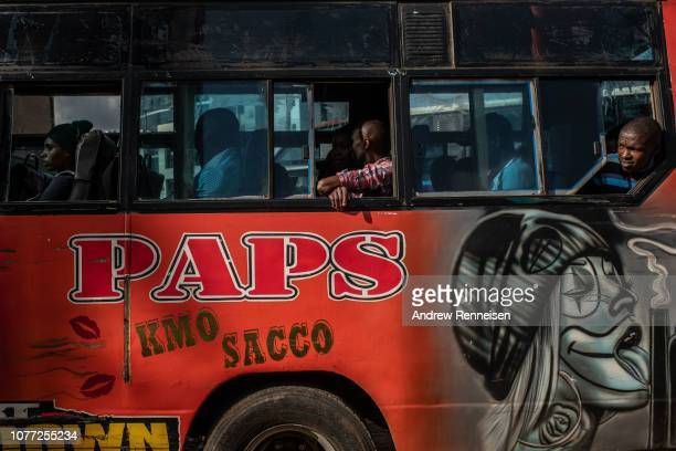 A matatu waits for more passengers at a bus stop on December 04 2018 in Nairobi Kenya The private minibuses were to have been banned from the city's...