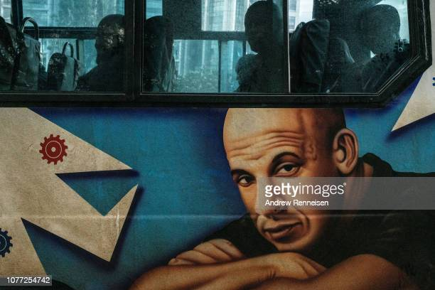 A matatu with a mural of Actor Vin Diesel drives past a bus stop on December 04 2018 in Nairobi Kenya The private minibuses were to have been banned...