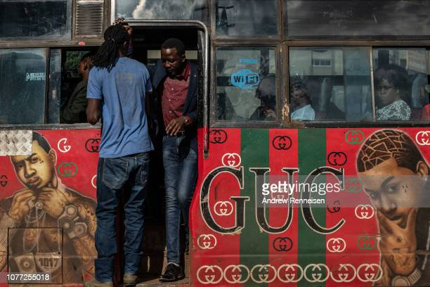 A matatu with a mural of American hip hop artists passes a bus stop on December 04 2018 in Nairobi Kenya The private minibuses were to have been...