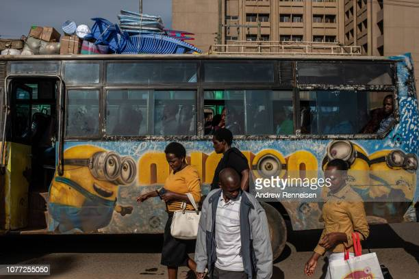 A matatu with a mural of the American comedy film characters Minions passes a bus stop on December 04 2018 in Nairobi Kenya The private minibuses...