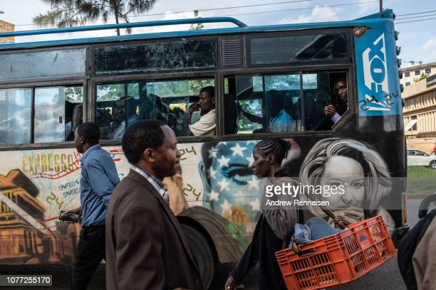 A matatu with a mural of the American television drama passes a bus stop on December 04 2018 in Nairobi Kenya The private minibuses were to have been...