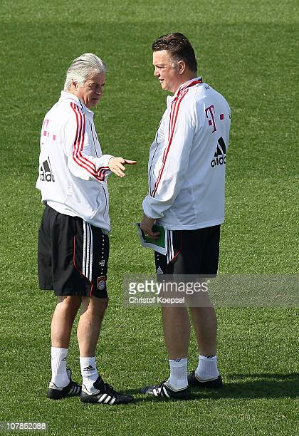 Match analyst Marcel Bout and head coach Louis van Gaal talk during the FC Bayern Muenchen training session at Aspire Academy for Sports Excellence...