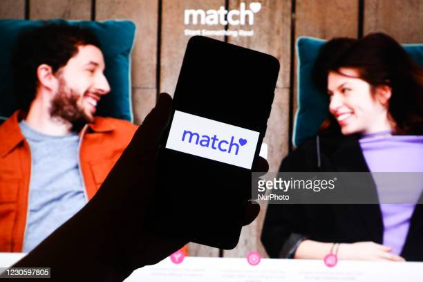Match app logo is displayed on a mobile phone screen photographed on Match website background. Krakow, Poland on January 15, 2021. Numbers show that...