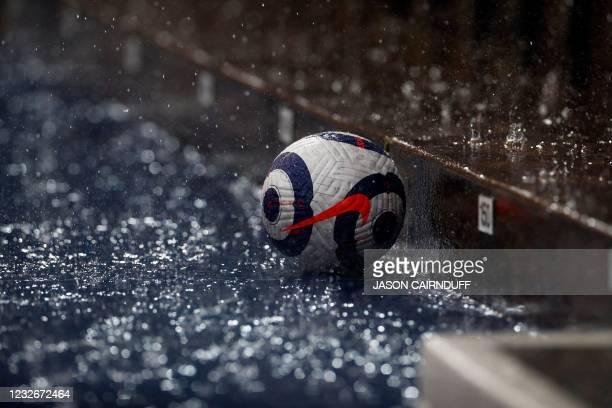 Match ball is seen in the rain during the English Premier League football match between West Bromwich Albion and Wolverhampton Wanderers at The...