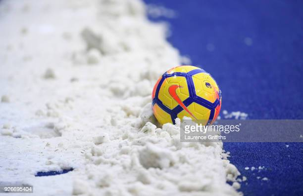 A match ball is seen in the snow ahead of the Premier League match between Leicester City and AFC Bournemouth at The King Power Stadium on March 3...