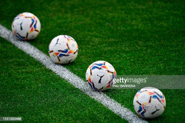 Match balls lie on the pitch as players warm up before the Spanish league football match between SD Huesca and Real Madrid at the El Alcoraz stadium...