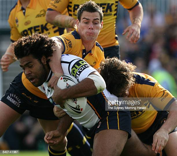NRL match between Parramatta Eels and Brisbane Broncos Sam Thaiday tackled by John Morris and Nathan Hindmarsh 27 August 2006 SMH Picture by CRAIG...