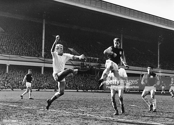 A match between West Ham United versus Arsenal Football Club in action Arsenal's Ian Ure jumps to meet Geoff Hurst at Upton Park London March 27th...