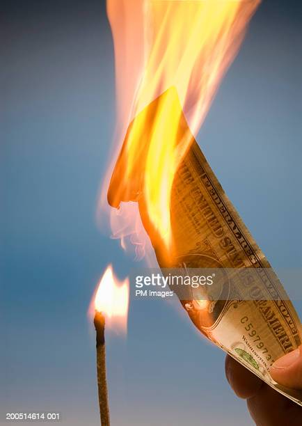 Match burning American dollar
