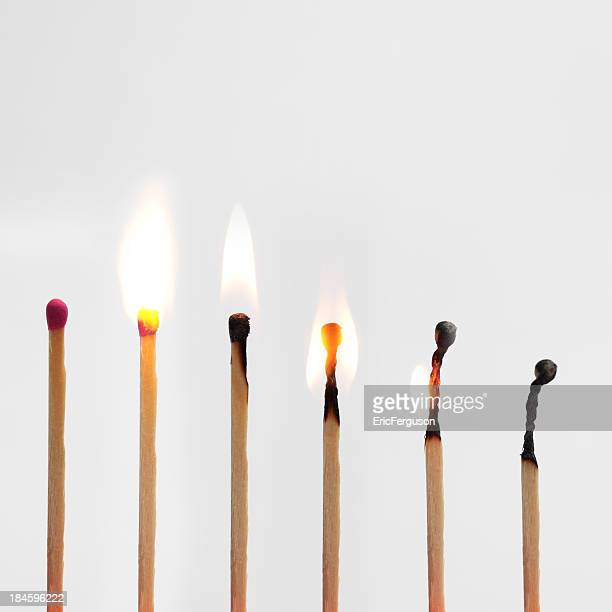 match burning down image progressionon grey - burning stock pictures, royalty-free photos & images