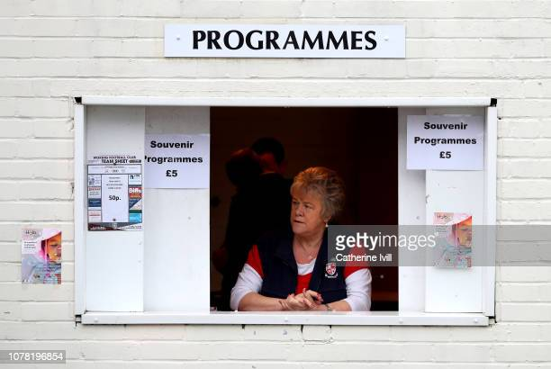 A match day programme seller is seen prior to the FA Cup Third Round match between Woking and Watford at Kingfield Stadium on January 6 2019 in...