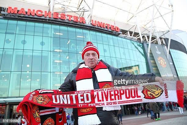 Match day scarves are sold outside the stadium prior to the UEFA Europa League round of 16 second leg match between Manchester United and Liverpool...