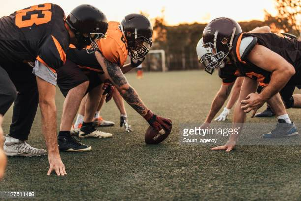 nfl match in motion - guard american football player stock photos and pictures