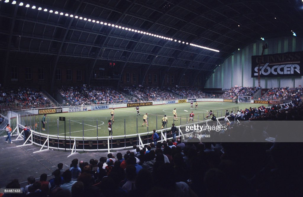 A match in progress during the Guinness Soccer Six Championships at the GMEX centre (now Manchester Central), Manchester, 9th December 1986.