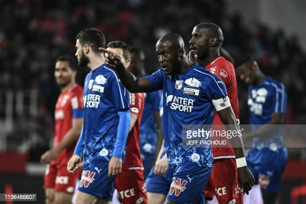 TOPSHOT Match is interrupted and Amiens' French defender Prince Desir Gouano points supporters after hearing racists insults during the French L1...