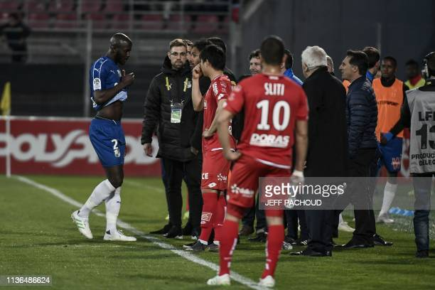 Match is interrupted as Amiens' French defender Prince Desir Gouano reports hearing racists insults during the French L1 football match between Dijon...