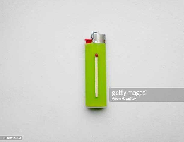 a match lies on a lighter - fiammifero foto e immagini stock