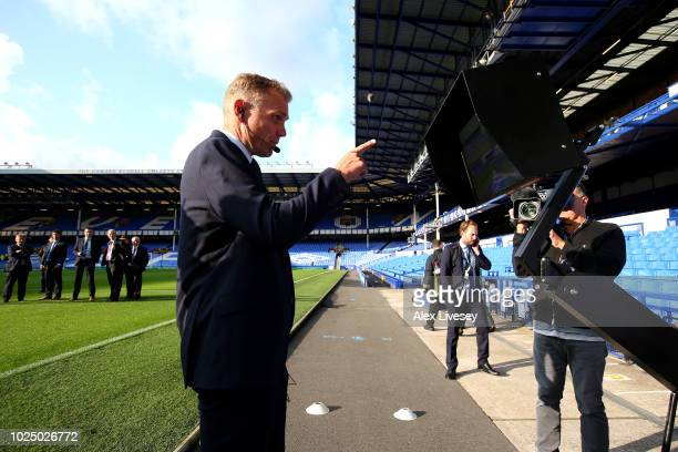 Match official Graham Scott checks the VAR display screen ahead of the Carabao Cup Second Round match between Everton and Rotherham United at...
