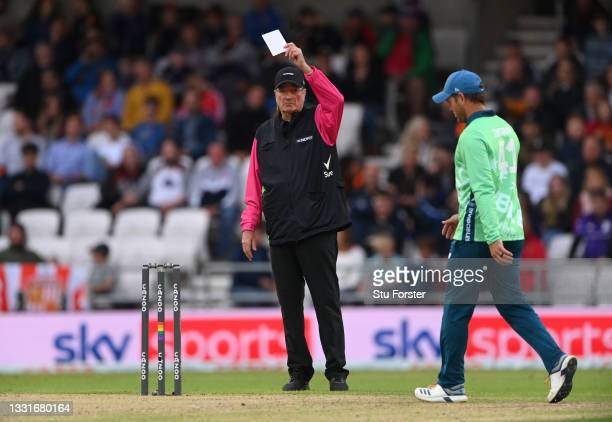 Match official Nick Cook holds up the white five balls bowled card during The Hundred match between Northern Superchargers Men and Oval Invincibles...