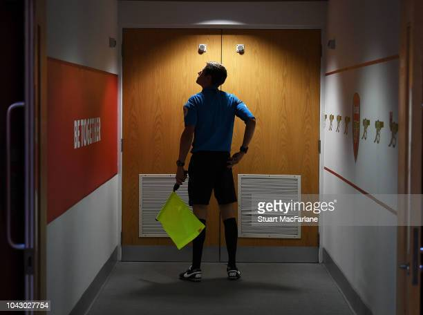 A match official outside the Arsenal changing room before the Premier League match between Arsenal FC and Watford FC at Emirates Stadium on September...