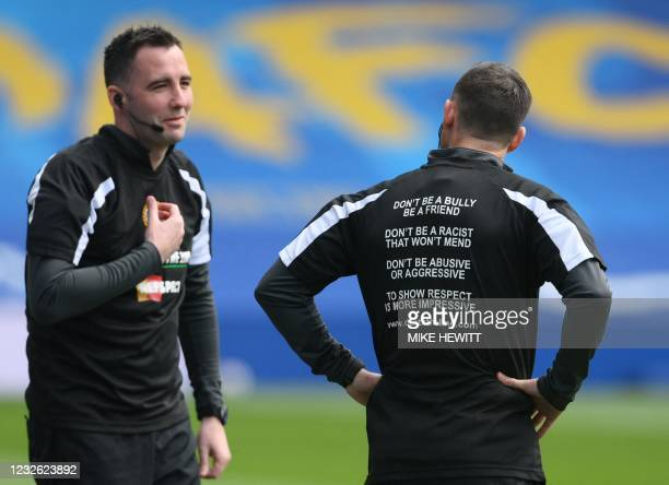 Match official wears a t shirt with a message about online abuse ahead of the English Premier League football match between Brighton and Hove Albion...