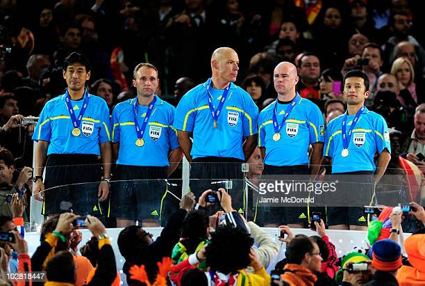 Match official with their medals fourth official Yuichi Nishimura assistant referee Darren Cann referee Howard Webb and assistant referee Michael...