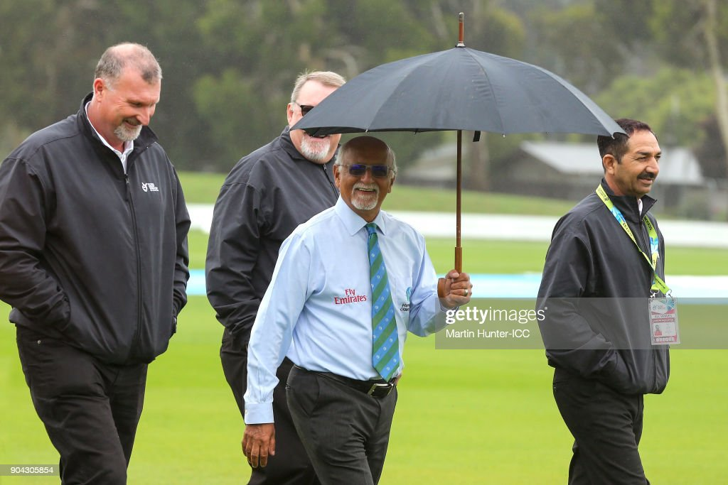 ICC match officials and umpires make an inspection as a wet outfield delays the start of the ICC U19 Cricket World Cup match between Bangladesh and Namibia at Bert Sutcliffe Oval on January 13, 2018 in Christchurch, New Zealand.