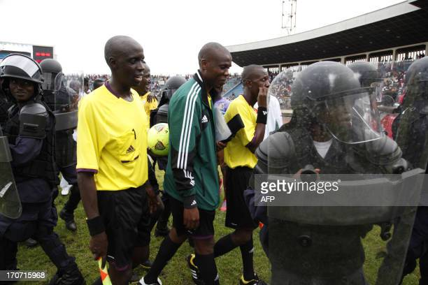 Match officials being heavily guarded by police after a crucial Brazil FIFA 2014 qualifier game between Liberian and Senegal on June 16 2013 at...