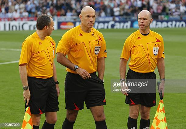 Match officials Darren Cann Howard Webb and Michael Mullarkey look on prior to the UEFA Champions League Final match between FC Bayern Muenchen and...