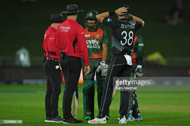 Match officials halt play after the scoreboard fails during game two of the International T20 series between New Zealand and Bangladesh at McLean...