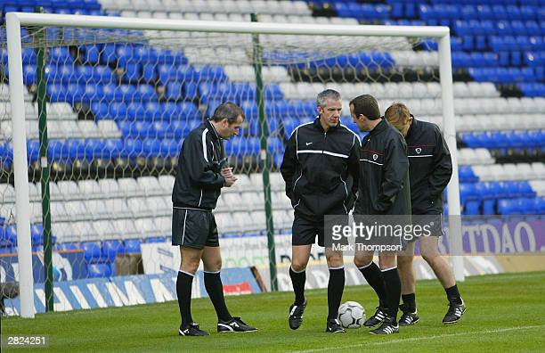 Match officials inspect a waterlogged pitch before the FA Barclaycard Premiership match between Birmingham City and Middlesbrough at St Andrews on...