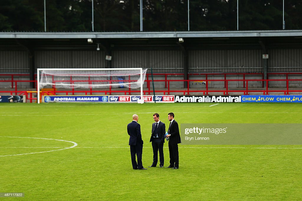 Match officials inspect the pitch prior to the FA Cup Qualifying Third Round match between Kingstonian and Eastbourne Borough at The Cherry Red Records Stadium on October 12, 2014 in Kingston upon Thames, England.