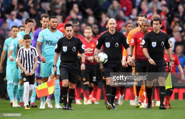 Match officials players and mascots walk out prior to the Premier League match between Manchester United and Newcastle United at Old Trafford on...