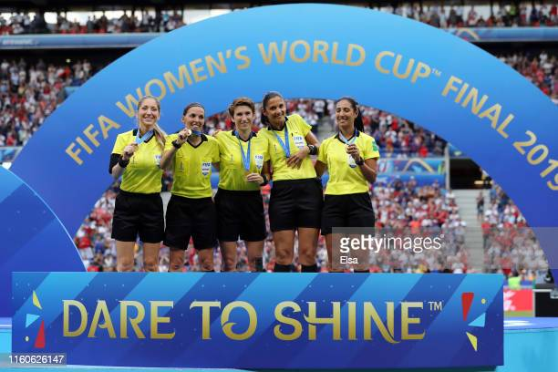 Match officials pose with their medals after the 2019 FIFA Women's World Cup France Final match between The United States of America and The...